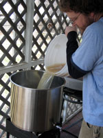 Dumping the wort into the kettle.